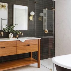"""Such a satisfying bathroom remodel before and after by @studio818.design, photographed by @laiacona_photography. The sconce is our Athena 6"""" in brass. Mid Century Modern Bathroom, Modern Master Bathroom, Wood Bathroom, Modern Bathroom Design, Bathroom Interior Design, Bathroom Flooring, Small Bathroom, Bathroom Vintage, Industrial Bathroom"""