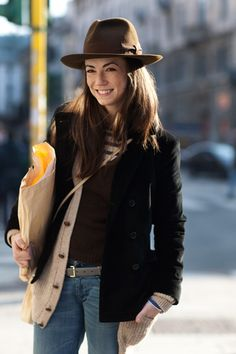 Outdoor errand outfit perfection. Will I ever wear such a hat? It's quite possible. By the Sartorialist.