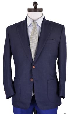 Luxire jacket constructed in Vitale Barberis Canonico - Estate Blue Hopsack: http://custom.luxire.com/products/vbc-vitale-barberis-canonico-estate-blue-hopsack-vbc_10_712_314 .  Consists of 3-2 roll button style, notch lapel, hip patch pockets, 4 functional kissing buttons at cuffs,internal ticket pockets and barchetta chest pocket.