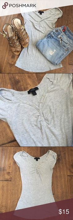 A must have Express grey top with buttons. Express grey top preloved and in perfect condition, like new. Goes with everything, u can wear it with heels, flats, jeans, pants, shorts and skirts. Fabric is super soft and comfy 👌🏻.  ⭐️Bundle for discounts.                                         ⭐️Ships out same day (except if purchased on a Saturday)                                                              ⭐️Smoke free home. Express Tops Tees - Short Sleeve