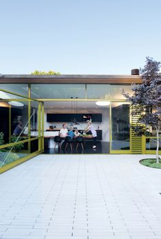 Mill Valley, California home of Dwell Magazine founder Lara Hedberg. The facade was designed by Bob Hatfield in 1996. A new glass and steel pivot door was designed by her husband, Chris Deam and fabricated by Sand Studios, was added in a renovation.