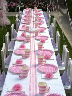 LIKE THE ribbon down the table to add pink to the white cloth
