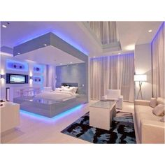 Cool bedroom! Blue Led lights in a modern white room. Follow our Pinterest board…