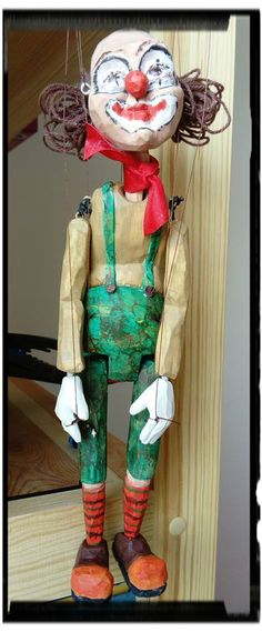 Small clown wooden puppet marionette.