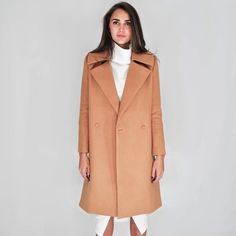 C/Meo Camel Tan Long Button Front Coat Available now!!! C/MEO Collective serves up a classic double breasted trench coat with an oversized bodice for a picture perfect - finish. This piece is designated to become a seasonal staple that will never go out of style. Designer carried by TopShop. (Available in XS, S, XL)                                                              Self: 88% polyester, 10% rayon, 2% elastane Lining: 97% polyester, 3% spandex Double breasted front  Padded shoulders…
