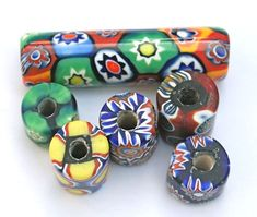 Millefiori trade beads, also known as mosaic beads or goulimine beads, these tube-shaped, multicolored beads feature flower-shaped designs created by layered glass. Translucent Glass, African Trade Beads, Beads Online, World Of Color, Old And New, Seed Beads, Glass Beads, Mosaic, Museum