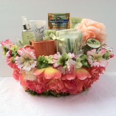 """(Spa Gift Basket) A cool and playful breeze blows into the glamour world, just in time for the summer to heat up with these playful colors, and with our one of a kind finest decorative design basket just for you with.  1 Spa Sock&Foot Lotion 1 Body Sponge 1 Candle 1 Cup 1 Body Spray 1 Crystal Light Lemonade 1 Lotion 1 Soap Rose Petals Ghirardelli Chocolate Squares Milk & Caramel rich chocolate,Luscious Filling  All Handmade.      """"Item Sold"""""""