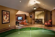 What a man cave!! Rustic barn doors AND indoor golf!!!