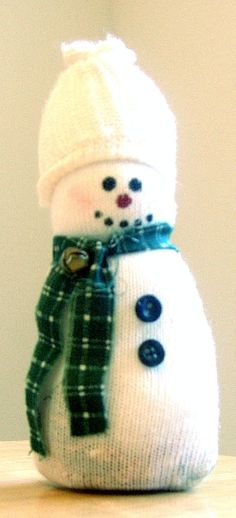 What to do with those single socks - reuse them to make Sock Snowman or choose some holiday theme A Christmas Craft for Kids - Photo by Donna Paulson
