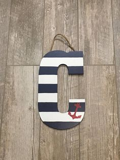 ** The paper mache (standing) letters P & F & J do NOT stand on their own ** Love the Nautical/Beach theme? This letter is for you! This letter is navy blue and white with a red anchor. - Hand-painted design on letters - Coated with clear acrylic sealant gloss Flat Letters: (wood) -