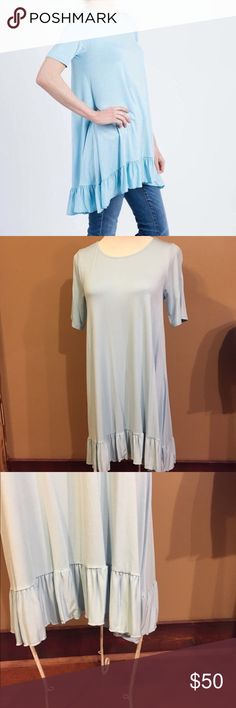Agnes & Dora Ruffle Tunic NWT Agnes & Dora Ruffle Tunic  The Ruffle Tunic makes a cute dress in the summer. Is great to wear with leggings or skinny jeans. This ruffle is light blue. See pictures for details. Agnes & Dora Tops Tunics
