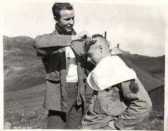 1944- U.S. soldier giving comrade a mohawk haircut in Kiska.