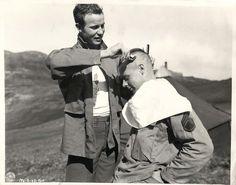 1944- U.S. soldier giving comrade a mohawk haircut in Kiska.