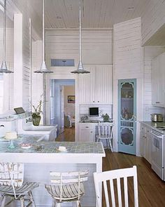 Love love the blue screen door to the pantry.  I could put baskets on front shelves and this would force me to keeo pantry cleaned out...love pendant lighting and tiled countertops too...