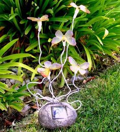 Add these beautiful Solar Powered Butterflies with 5 Blinking LEDs Garden Solar Light by Garden to your yard, $18.50 from Amazon.