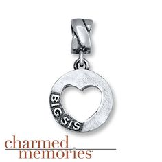 """From the Charmed Memories® collection, """"Big Sis"""" is depicted around a heart-shaped frame of sterling silver."""