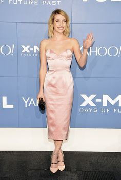 Emma Roberts - love that dress as it does all the right things to define her waist