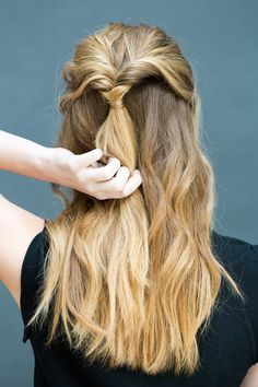With your finger, create a little hole above the elastic and loop the pony through it.    - MarieClaire.com