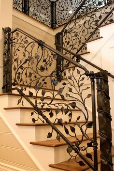 Gorgeous wrought iron vine and leaf railings, handmade at a small metal shop.