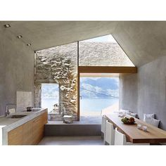 Stunning historic stone house restoration in the lakeside village of Scaiano, Switzerland. By Wespi de Meuron Romeo Architecture. Photography by Hannes Henz. #architecture #interiordesign #restoration #interiors #natural #stone #architecturelovers #texture