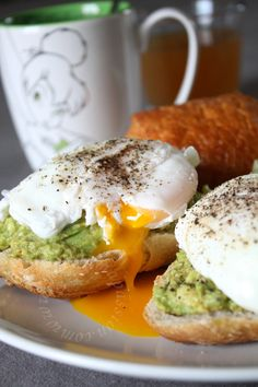 Ingredients: For poached eggs: - water - 2 organic eggs - 1 tablespoon vinegar - Coarse salt For mashed avocado: – 2 ripe avocados – half a teaspoon red bell pepper powder – salt – lemon – 1 teaspoon of olive oil – ground coarse Cayenne pepper (optional) – Baguette toasts  Instructions: For poached eggs: Make sure your eggs are really fresh. Add a small dash of vinegar and some coarse salt to a pan of steadily simmering water. Crack eggs individually into a ramekin or cup. Slowly tip the egg…