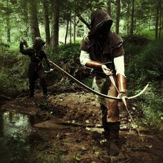 layered clothing , light leather hood, long bow, no blades?