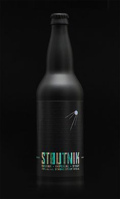 Stoutnik Russian Imperial Stout, from Longwood Brewery. The packaging design features a matte black bottle, prismatic foil stamp on the logo and wordmark, and an embossed Morse Code story about the beer. Design by Hired Guns.