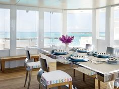 The bridge deck's dining salon is centered by an adjustable-height table set with china designed by Christian Lacroix for Vista Alegre; the chargers, napkins, and napkin rings are by Kim Seybert. The chairs are by Philippe Starck for Sutherland; a Missoni fabric from Stark trims the seat cushions.