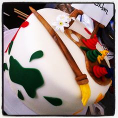 Artist Theme Cake-- German chocolate cake, pecan filling, the brush, easel, palette, and paints are made out of molding chocolate, the paper is sugar paper