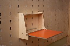 folding desk, that also looks like it comes off the plywood wall so can be moved to any height/position.