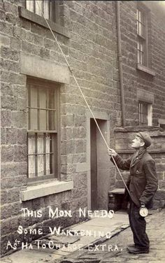 A knocker-upper, location unknown, but taken in the North of England.