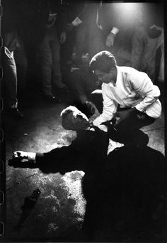 """Robert Kennedy's  assassination June 5, 1968, LIFE's Bill Eppridge was there — and managed to capture the one haunting image that helped define the era. The original caption that ran in LIFE: """"Rigid, semiconscious, his face an ashen mask, Senator Kennedy lies in a pool of his own blood on the concrete floor, a bullet deep in his brain and another in his neck. Juan Romero, a busboy whose hand Kennedy had shaken before the shots, tried to comfort him."""""""