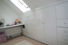 Cupboards in eaves space right up to velux window height