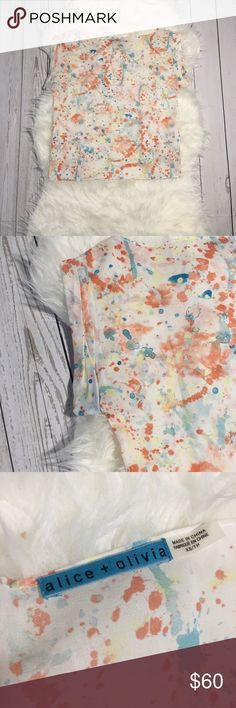 """Alice + Olivia Silk Watercolor Print Shirt XS Gently used. No flaws. Comes from pet free and smoke free home.   Please note, items may arrive slightly wrinkled due to storage and shipping.   All measurements are approximate.  Armpit to armpit flat: 18"""" Length: 20.5"""" Alice + Olivia Tops Blouses"""