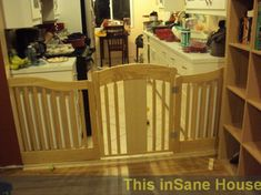 Baby Gate From Reclaimed Crib, How to make a baby gate for a large opening from a reclaimed crib!  Looks better then commercial gates! For a detailed tutorial check it out at our website: http://thisinsanehouse.blogspot.com/2013/08/the-crib-gate-scandal.html, Baby gate final view from living room , Nurseries Design