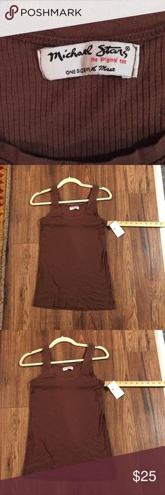 """Michael Stars Boyfriend Tank Tee, OSFM! A yummy chocolate brown, this is a perfect tee for layering!  I love that the care tag says ENJOY!  50% Supima, 50% Micro Modal, you owe it to yourself to feel the softness of this shirt ❤️. 14"""" from armpit to armpit (unstretched),  and. """" from shoulder to bottom. Can be very stretched! Michael Stars Tops Tank Tops"""