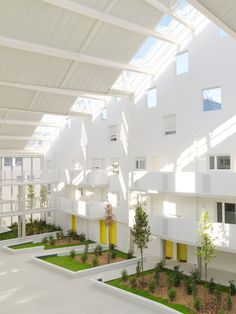 An old submarine base in Bordeaux provided the site for this docklands housing complex by Agence Nicolas Michelin & Associés, where homes and gardens are arranged on either side of a glazed atrium Architecture Résidentielle, Industrial Architecture, Amazing Architecture, Co Housing, Social Housing, Bordeaux, Atrium Garden, Hotels, Urban Design