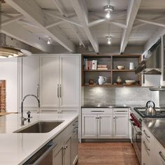 Brownstone garden-level kitchen with exposed ceiling joists ...