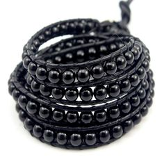 Black on Black Pearl is made with breathtaking aegirine circular beads around wrapped dark black leather.  100% hand made. Incredible focus on details.  http://www.florencescoveljewelry.com/collections/wrap-bracelet/products/black-on-black-pearl