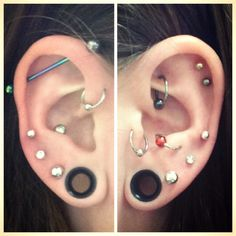 Ear art - and I am a mechanical engineer. Industrial. Rook. Conch. Tragus. Helix. Body piercing.