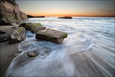 Photograph of California ocean waves at sunset against the rocky beach coastline. A great gift for your girlfriend in a large gallery wrapped canvas or print 11x14 16x20 16x24 20x30 24x36 and 32x48. Image title: Coming Ashore This fine art image is from my photography series of moving water. All photographs are original and photographed by artist Bob Estrin. Photographs are available in a variety of sizes as a print or as a gallery wrapped canvas. Photograph sizes available: Using the...