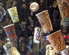 Artist draws on thousands of coffee cups for window in NY