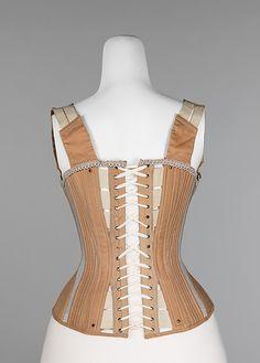 "Corset, 1887-90. American. Cotton, metal, bone, elastic. Marking: ""Mdm. McCabe's Sanative Corset"" Metropolitan Museum of Art."
