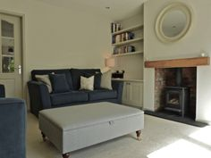 Bespoke upholstery - grey wool ottoman and navy blue linen sofas
