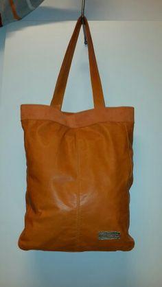 Orange power. Leather tote