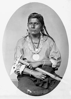 Portrait (Front) of Kit-Toox (Beaver) - Pawnee in Partial Native Dress with Two Peace Medals and Ornaments and Holding Pipe-tomahawk 1868 by William Henry Jackson (1843-1942)
