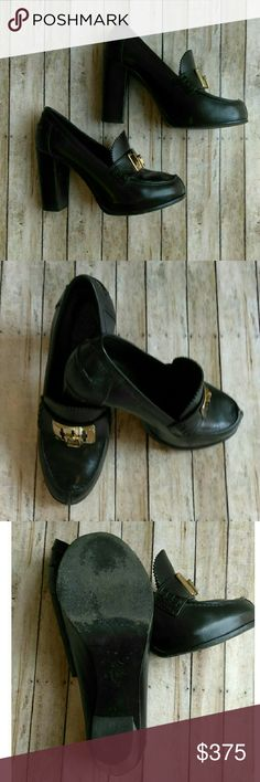 """Tory Burch Black Leather HOWIE Pumps These shoes are gorgeous, well made and Versatile. Tory Burch """" Howie"""" Oxford style Heeled Shoes. Gold emblem on front. Women's size 9M . Thick heel about 4-1/2 inch heel. EUC! Retail Price is $375 The bottom of the shoe the symbol is worn out on one but on the other you can see a portion of this. Very minor creases on toe portion. Not noticeable due to the quality of leather and color.   - Bundle for an extra 20% in savings - I accept reasonable mature…"""