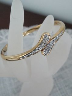 Old, Classic, Elegance vintage bangle.    http://www.etsy.com/listing/122264394/costume-jewelry-gold-plated-crystal?