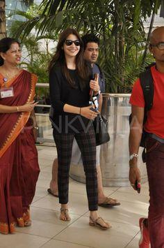 Anushka Sharma's airport look consisting of Zara pants, a black tee, thong sandals and a Kate Spade bag