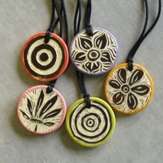 These handcarved pendants were made from a little slab of porcelain clay using the tiniest little carving tool I could find,